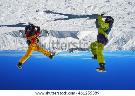 Two snowboarders are on hand in the high mountains in the winter.