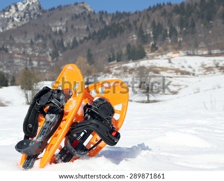 two snowshoes in mountains in winter - stock photo