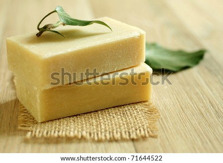 Two soap and green leaf on wooden.Spa products - stock photo