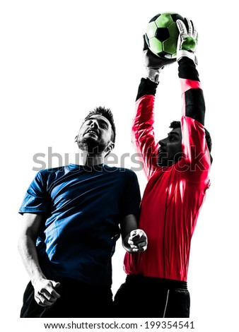 two  soccer player goalkeeper men catching heading ball competition in silhouette isolated white background - stock photo
