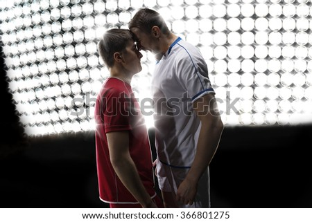 Two soccer players is swearing and shout - stock photo