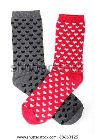 two socks with small hearts