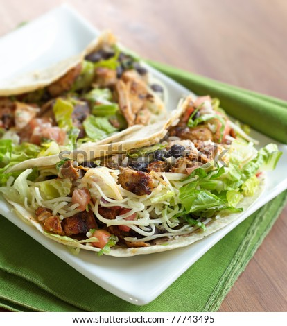 two soft shell chicken tacos shot with selective focus - stock photo