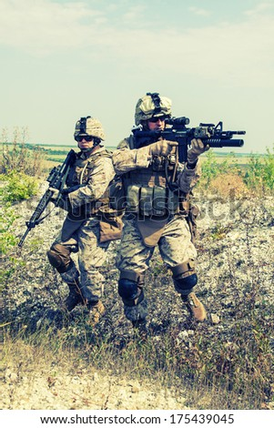 Two soldiers in the mountains during the military operation - stock photo