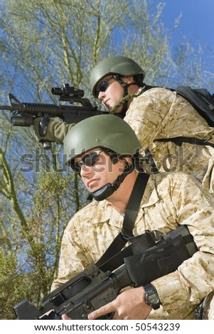 Two soldiers on patrol, outdoors