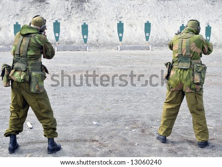 Two soldiers practicing shooting - stock photo