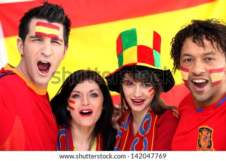 Two Spanish couples supporting their national team