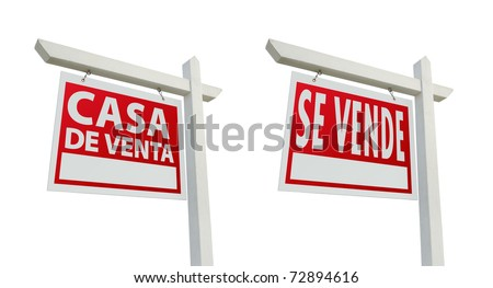 Two Spanish House For Sale Real Estate Signs with Clipping Paths Isolated on a White Background. - stock photo