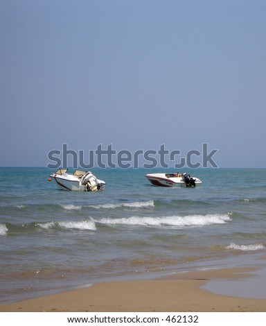 Two speed boats on the ocean