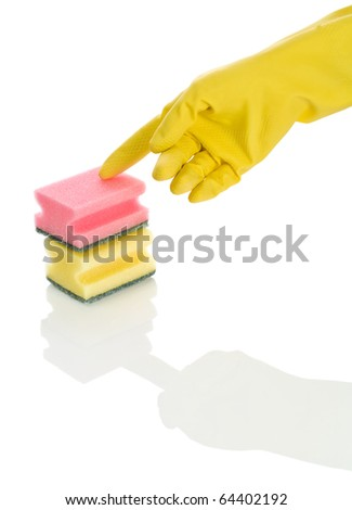 two sponges and hand in glove