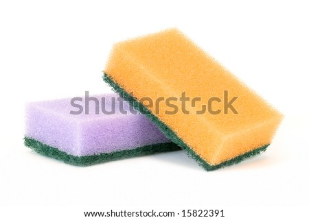 Two sponges lay on a white surface