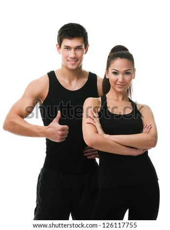 Two sportive people in black sports wear, isolated on white - stock photo