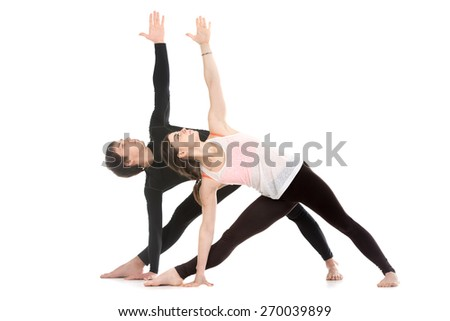 Two sporty people practice yoga with partner, couple doing stretching exercise, extended triangle pose, utthita trikonasana