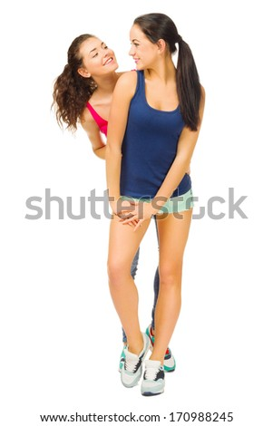 Two sporty young girls isolated - stock photo