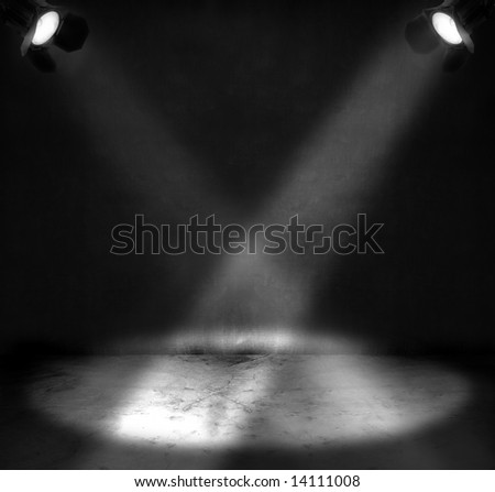 Two spotlights shining on a grungy floor in a room - stock photo