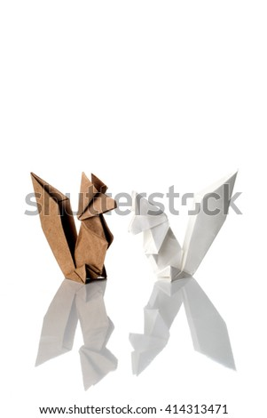 Two squirrels origami made of white and craft paper isolated on white background.