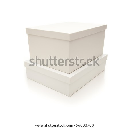 Two Stacked White Boxes with Lids Isolated on a White Background. - stock photo
