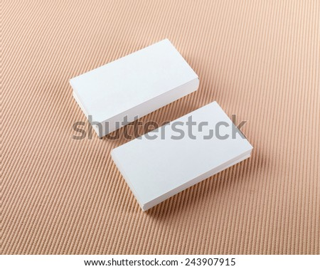 Two stacks of blank business cards on a colored background. Template for ID. - stock photo
