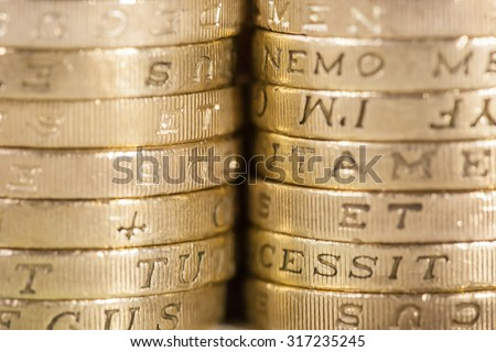 Two stacks of UK pound coins forming a background - stock photo