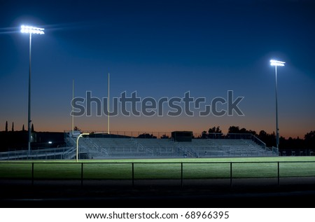 two stadium lights sparkle in the night - stock photo