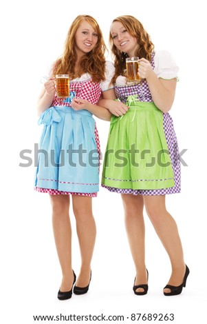 two standing bavarian woman with beer on white background - stock photo