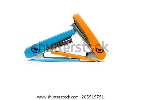 two staplers having a fight