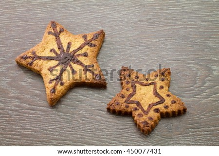 two stars of decorated pastry on wooden table
