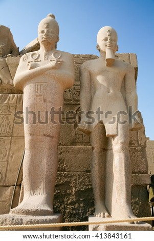 two statues sculptures of Egyptian pharaoh king in landmark Temple of Karnak, monument declared a World Heritage by Unesco, in Luxor, Egypt, Africa - stock photo