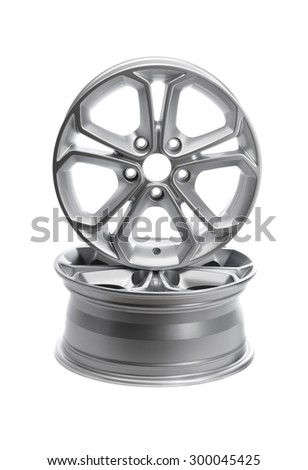 Two steel alloy car rims on a white background. - stock photo