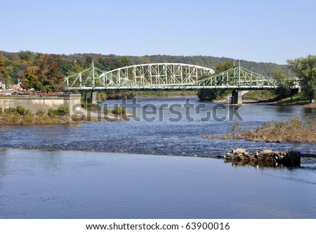 Two steel bridges that connect the cities of Easton, Pennsylvania and Phillipsburg, New Jersey.  The bridges span over the Delaware River. - stock photo