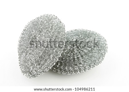 Two steel scourers together on a white background. - stock photo