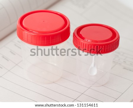Two sterile medical containers on medical blank - stock photo
