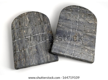 Two stone tablets representing the ten commandments on an isolated background  - stock photo