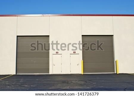 Two Storage Gates For Trucks. Storage Gates - Commercial Building, - stock photo