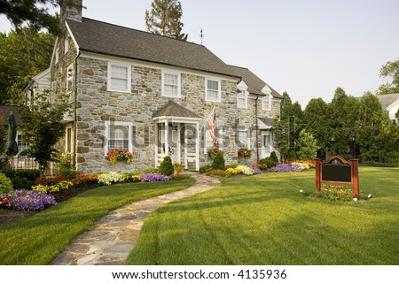 Two story bed and breakfast made from rock - stock photo