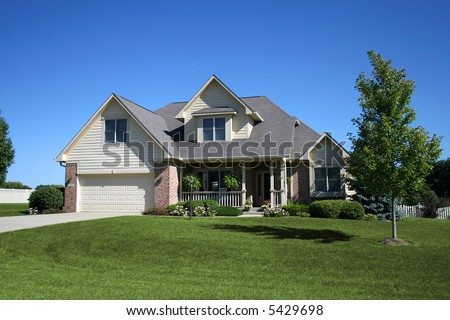 two-story brick and siding home - stock photo