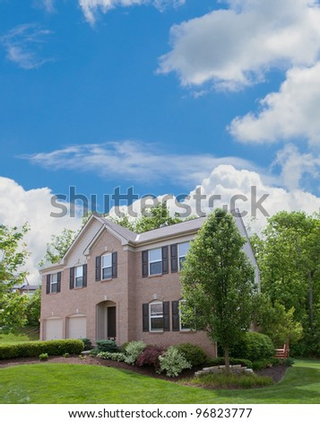 Two-Story Brick and Vinyl Siding House - Back yard of a two-story vinyl siding houses in the suburbs in America. - stock photo