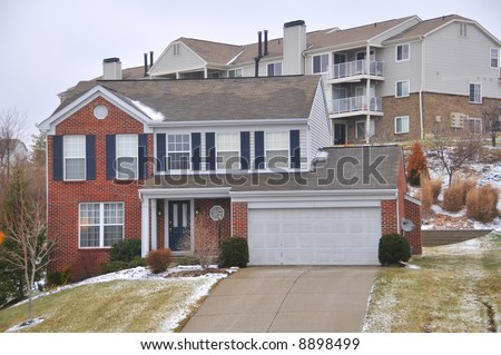 Two story brick house in winter. - stock photo