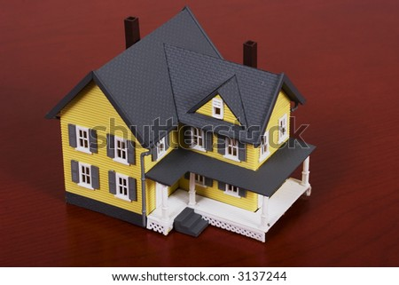 Two-story house with red wooden background background - stock photo