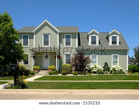 Two story vinyl siding house in the suburbs. - stock photo