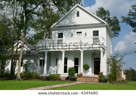 two-story white house in small American town - stock photo