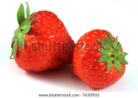 two strawberry close-up on white background  and a bit of shadow