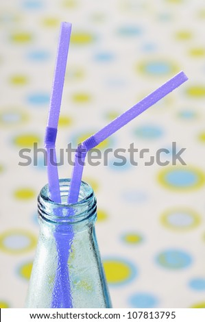 Two straws in a bottle - stock photo