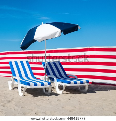 Two stripy beach chairs