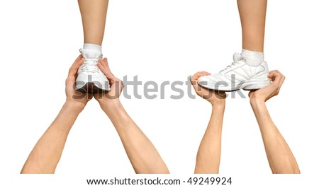 Two strong male hands holding one female foot. Teamwork, support, competition concept. Isolated on white background - stock photo