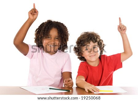 Two student children with their hands raised up - stock photo