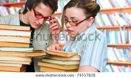 two students are in a library, prepare to employments