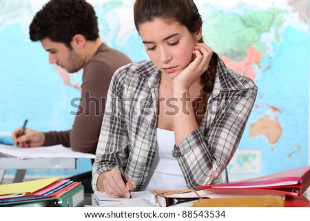 Two students hard at work - stock photo