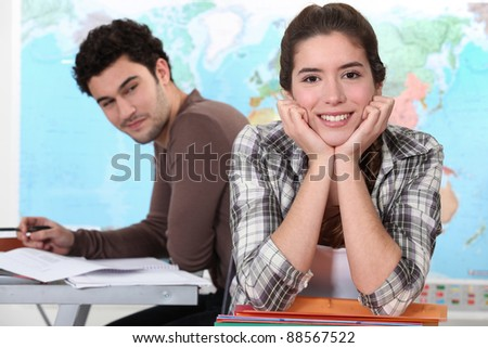Two students in geography classroom - stock photo