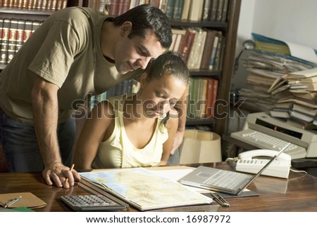 Two students looking at map - stock photo